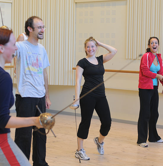 Opera students rehearsing fencing